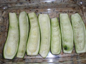 hollowed out zucchinis ready to be filled with stuffing